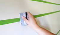 Burnishing-Painter's-Tape-with-a-Credit-Card