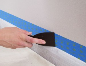 Burnishing-Painter's-Tape-with-a-Putty-Knife